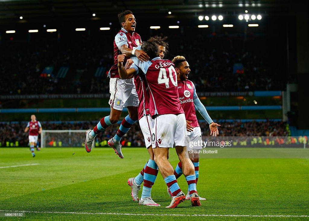Rudy Gestede of Aston Villa celebrates scoring their first with Jack Grealish and Scott Sinclair of Aston Villa during the Capital One Cup third round match between Aston Villa and Birmingham City at Villa Park on September 22, 2015 in Birmingham, England.