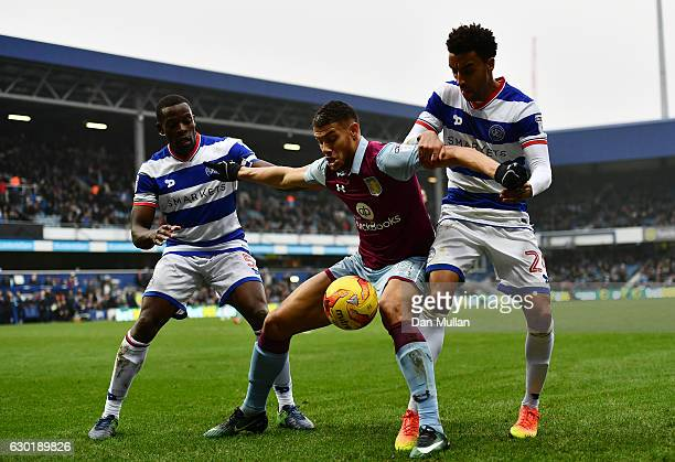 Rudy Gestede of Aston Villa holds off Nedum Onuoha of Queens Park Rangers and James Perch of Queens Park Rangers during the Sky Bet Championship...
