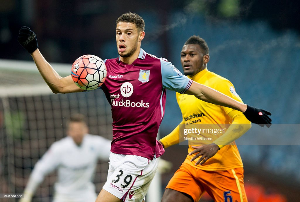 Rudy Gestede of Aston Villa is challenged by Aaron Pierre of Wycombe Wanderers during the FA Cup Third Round Relay match between Aston Villa and Wycombe Wanderers at Villa Park on January 19, 2016 in Birmingham, England.