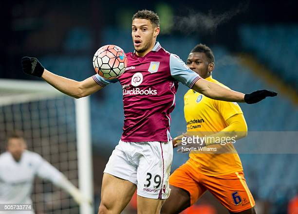 Rudy Gestede of Aston Villa is challenged by Aaron Pierre of Wycombe Wanderers during the FA Cup Third Round Relay match between Aston Villa and...