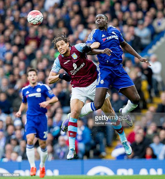 Rudy Gestede of Aston Villa is challenged by Baba of Chelsea during the Barclays Premier League match between Chelsea and Aston Villa at Stamford...