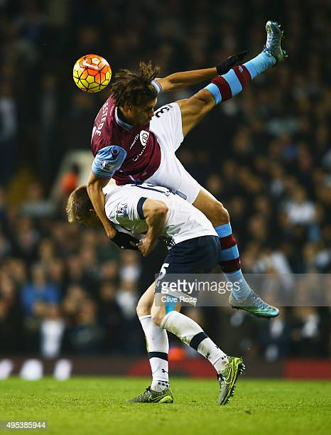 Rudy Gestede of Aston Villa jumps over Eric Dier of Tottenham Hotspur during the Barclays Premier League match between Tottenham Hotspur and Aston...