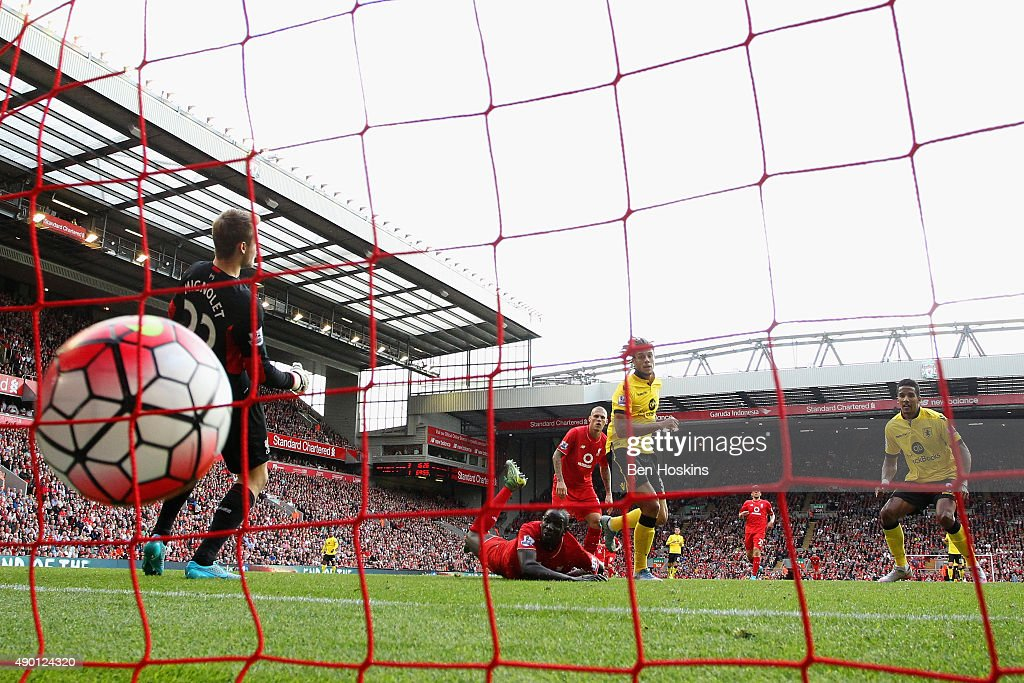 Rudy Gestede (2nd R) of Aston Villa scores his team's second goal during the Barclays Premier League match between Liverpool and Aston Villa at Anfield on September 26, 2015 in Liverpool, United Kingdom.