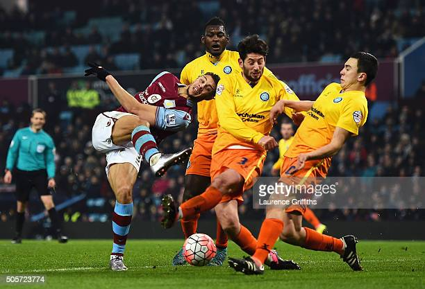 Rudy Gestede of Aston Villa shoots at goal while Wycombe defense attempt to block during the Emirates FA Cup Third Round Replay match between Aston...