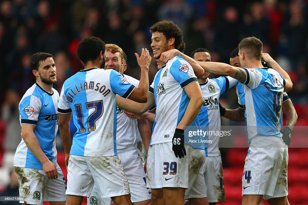 Rudy Gestede of Blackburn (C) celebrates scoring their second goal from the penalty spot with team mates during the FA Cup Fifth Round match between Blackburn Rovers and Stoke City at Ewood park on February 14, 2015 in Blackburn, England.