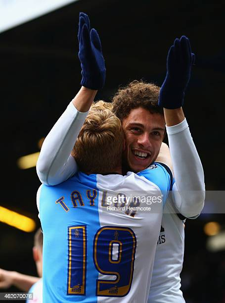 Rudy Gestede of Blackburn Rovers celebrates with Chris Taylor as he scores their second goal during the FA Cup Fourth Round match between Blackburn...