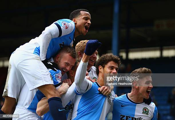 Rudy Gestede of Blackburn Rovers celebrates with team mates as he scores their second goal during the FA Cup Fourth Round match between Blackburn...