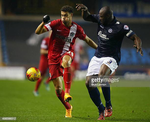 Rudy Gestede of Blackburn Rovers is tackled by Danny Shittu of Millwall during the Sky Bet Championship match between Millwall and Blackburn Rovers...