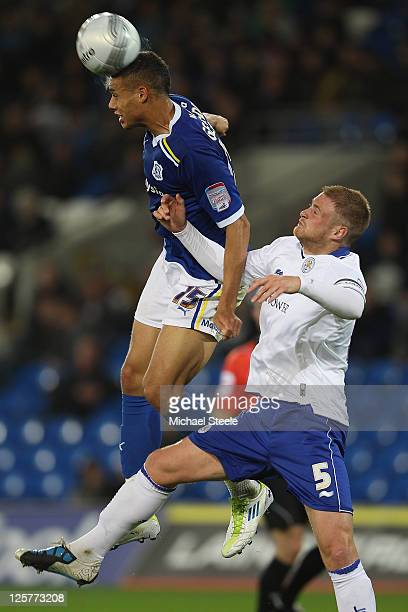 Rudy Gestede of Cardiff City wins a header from Matt Mills of Leicester City during the Carling Cup third round match between Cardiff City and...