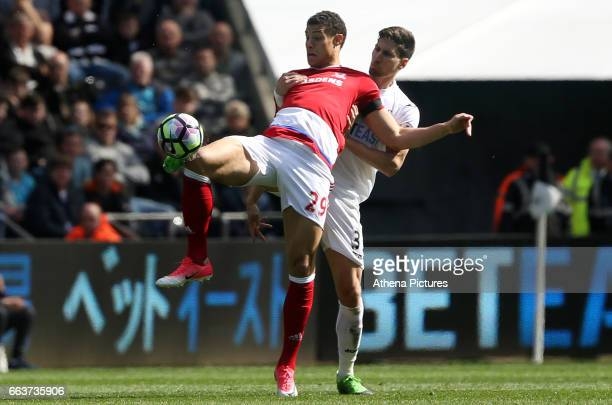 Rudy Gestede of Middlesbrough is challenged by Federico Fernandez of Swansea City during the Premier League match between Swansea City and...