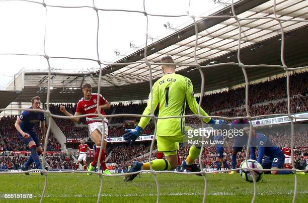 Rudy Gestede of Middlesbrough scores his sides first goal past David De Gea of Manchester United during the Premier League match between...