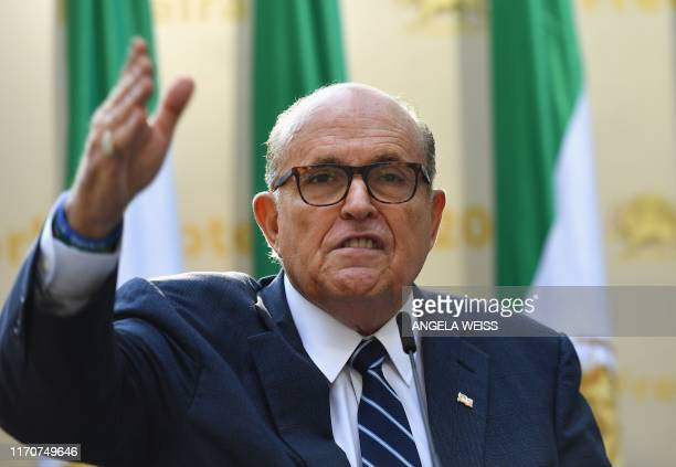 Rudy Giuliani Former Mayor of New York City speaks to the Organization of Iranian American Communities during their march to urge recognition of the...