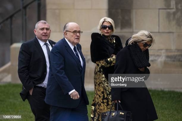 Rudy Giuliani former mayor of New York second left arrives for a state funeral service for former President George HW Bush at the National Cathedral...