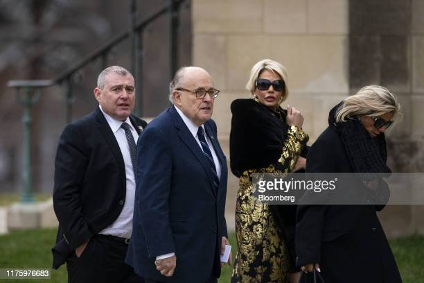 Rudy Giuliani former mayor of New York second left arrives with his associate Lev Parnas left before a state funeral service for former President...