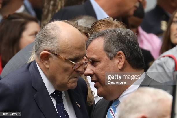 Rudy Giuliani, former New York City Mayor and attorney for President Donald Trump, and Chris Christie, former New Jersey governor, speak with each...