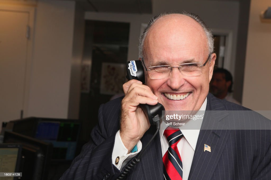 Rudy Giuliani fundraises at the Annual Charity Day Hosted By Cantor Fitzgerald And BGC at the Cantor Fitzgerald Office on September 11, 2013 in New York, United States.