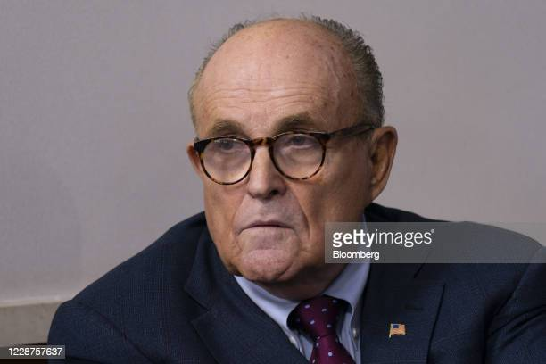 Rudy Giuliani personal lawyer to US President Donald Trump listens as President Donald Trump speaks during a news conference in the James S Brady...