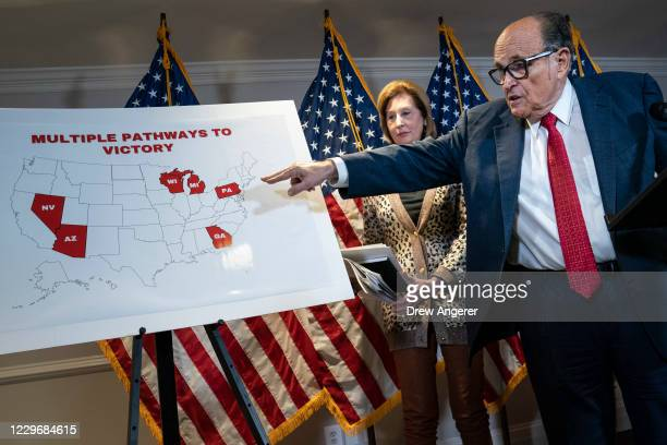 Rudy Giuliani points to a map as he speaks to the press about various lawsuits related to the 2020 election, inside the Republican National Committee...
