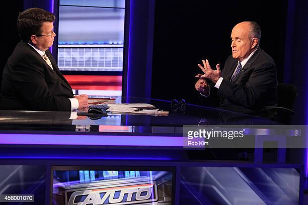 """Rudy Giuliani talks with host Neil Cavuto on the set of """"Cavuto"""" on FOX Business Network at FOX Studios on September 23, 2014 in New York City."""