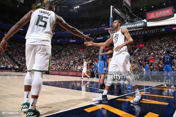Rudy Gobert and Derrick Favors of the Utah Jazz high five during the game against the Oklahoma City Thunder on October 21 2017 at Vivint Smart Home...