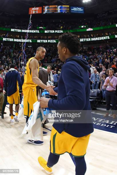 Rudy Gobert and Donovan Mitchell of the Utah Jazz shake hands after the game against the Phoenix Suns on March 15 2018 at vivintSmartHome Arena in...