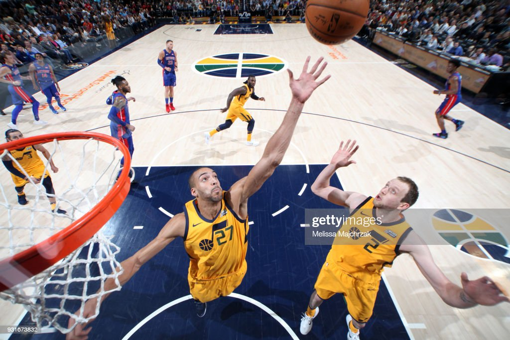 Rudy Gobert #27 and Joe Ingles #2 of the Utah Jazz jump for the rebound against the Detroit Pistons on March 13, 2018 at vivint.SmartHome Arena in Salt Lake City, Utah.