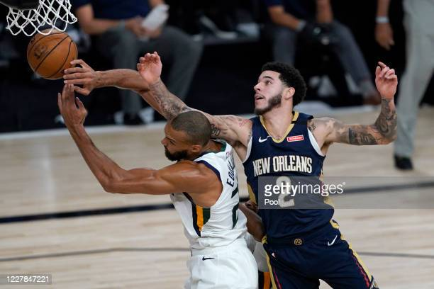 Rudy Gobert and Lonzo Ball of the New Orleans Pelicans battle for a loose ball during the second half at HP Field House at ESPN Wide World Of Sports...