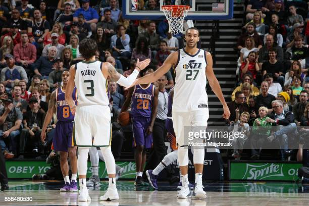Rudy Gobert and Ricky Rubio of the Utah Jazz high five during the game against the Phoenix Suns on October 6 2017 at vivintSmartHome Arena in Salt...