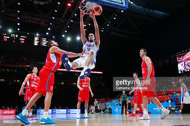 Rudy Gobert of France is dunking the ball against Nemanja Bjelica of Serbia during the EuroBasket 3rd place game between France v Serbia at Stade...