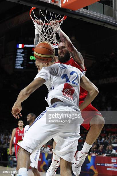 Rudy Gobert of France is in action against Miroslav Raduljica of Serbia during the 2014 FIBA World Basketball Championship SemiFinal basketball match...