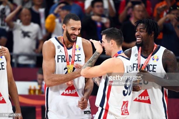 Rudy Gobert of Team France and Paul Lacombe of Team France celebrate after the games against the Australian Boomers during the Third Place Game of...
