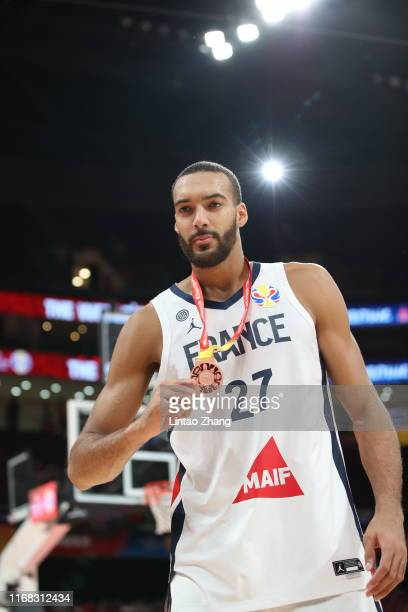 Rudy Gobert of the France National Team celebrate their victory during the cup ceremony after the FIBA World Cup 2019 against the Australia National...