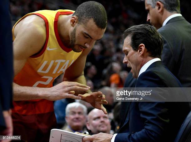 Rudy Gobert of the Utah Jazz and head coach Quin Snyder discuss a play during the second half of a game against the Golden State Warriors won by the...