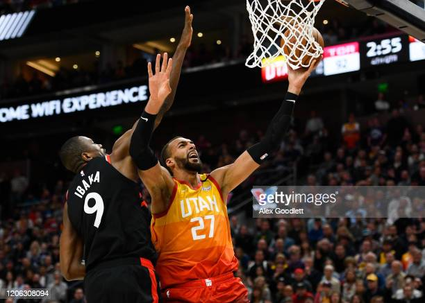 Rudy Gobert of the Utah Jazz attempts a shot under Serge Ibaka of the Toronto Raptors during a game at Vivint Smart Home Arena on March 9 2020 in...