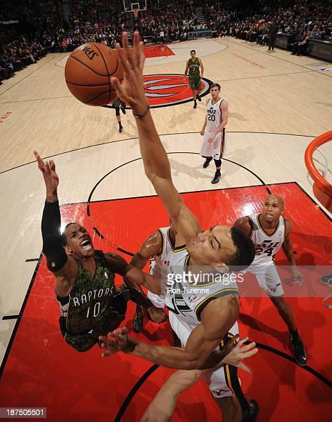 Rudy Gobert of the Utah Jazz blocks a shot against DeMar DeRozan of the Toronto Raptors on November 9 2013 at the Air Canada Centre in Toronto...