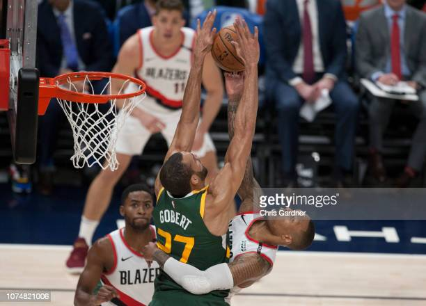 Rudy Gobert of the Utah Jazz blocks a shot attempt by Damian Lillard of the Portland Trail Blazers during their game at the Vivint Smart Home Arena...