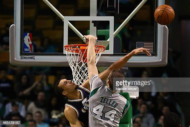 Rudy Gobert of the Utah Jazz blocks a shot from Tyler Zeller of the Boston Celtics during the second half at TD Garden on March 4 2015 in Boston...