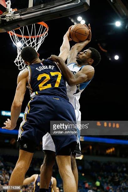 Rudy Gobert of the Utah Jazz blocks Andrew Wiggins of the Minnesota Timberwolves shot during the game on March 30 2015 at Target Center in...
