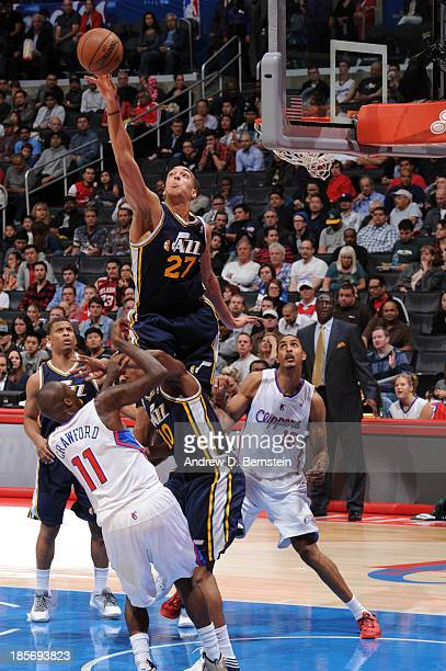 Rudy Gobert of the Utah Jazz blocks the shot against Jamal Crawford of the Los Angeles Clippers at Staples Center on October 23 2013 in Los Angeles...