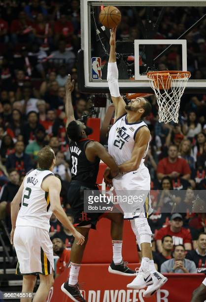 Rudy Gobert of the Utah Jazz blocks the shot attempt by James Harden of the Houston Rockets as Joe Ingles looks on during the fiorst half of Game...
