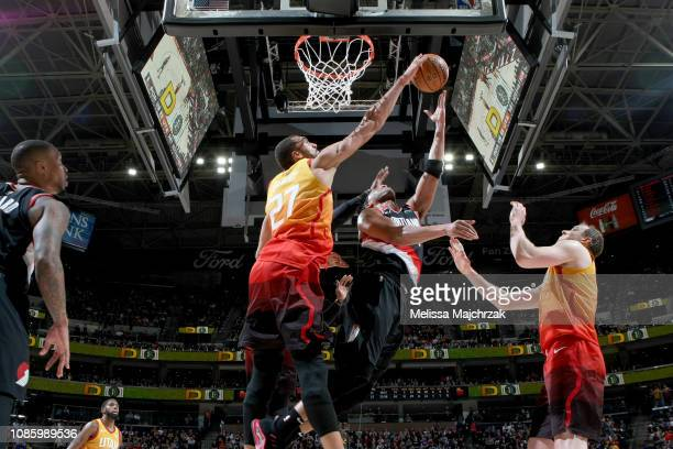 Rudy Gobert of the Utah Jazz blocks the shot by Evan Turner of the Portland Trail Blazers during the game on January 21 2019 at vivintSmartHome Arena...