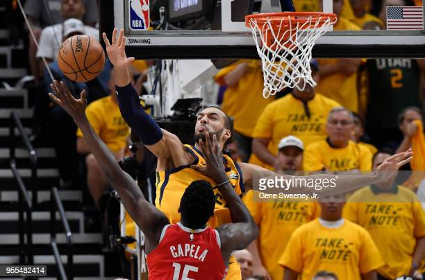 Rudy Gobert of the Utah Jazz blocks the shot of Clint Capela of the Houston Rockets in the first half during Game Four of Round Two of the 2018 NBA...