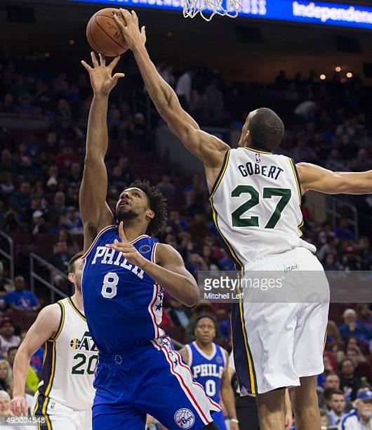 Rudy Gobert of the Utah Jazz blocks the shot of Jahlil Okafor of the Philadelphia 76ers on October 30 2015 at the Wells Fargo Center in Philadelphia...