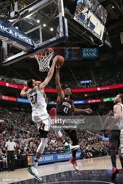 Rudy Gobert of the Utah Jazz blocks the shot of Nene Hilario of the Houston Rockets on November 29 2016 at vivintSmartHome Arena in Salt Lake City...