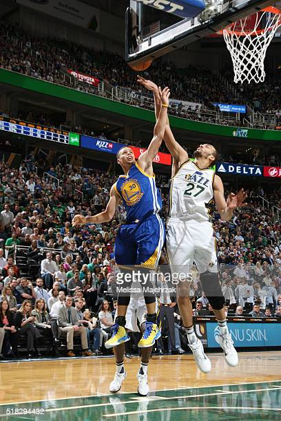 Rudy Gobert of the Utah Jazz blocks the shot of Stephen Curry of the Golden State Warriors during the game on March 30 2016 at vivintSmartHome Arena...