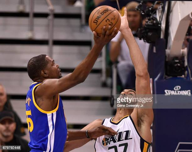 Rudy Gobert of the Utah Jazz blocks this first half shot by Kevin Durant of the Golden State Warriors in Game Three of the Western Conference...