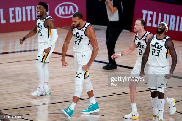 Rudy Gobert of the Utah Jazz celebrates a defensive stop with teammates Royce O'Neale, Joe Ingles and Donovan Mitchell against the the Denver Nuggets...