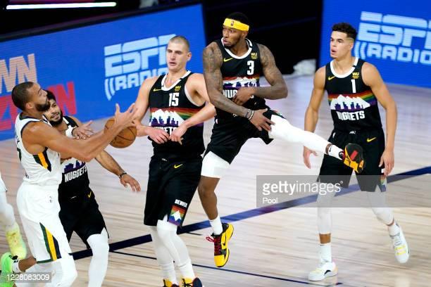 Rudy Gobert of the Utah Jazz competes for a rebound against Denver Nuggets players Jamal Murray, Nikola Jokic, Torrey Craig and Michael Porter Jr.#1...