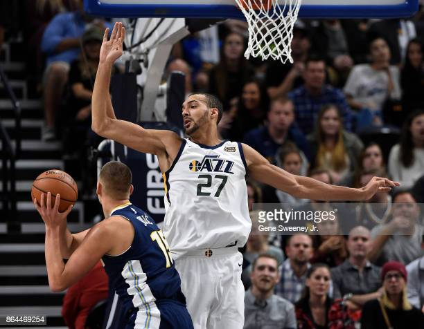 Rudy Gobert of the Utah Jazz defends against Nikola Jokic of the Denver Nuggets during their game at Vivint Smart Home Arena on October 18 2017 in...