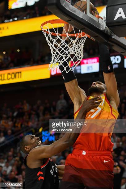 Rudy Gobert of the Utah Jazz dunks over Serge Ibaka of the Toronto Raptors during a game at Vivint Smart Home Arena on March 9 2020 in Salt Lake City...